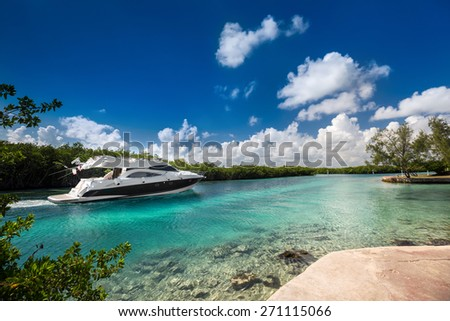 Luxury private motor yacht sailing out at sea  - stock photo