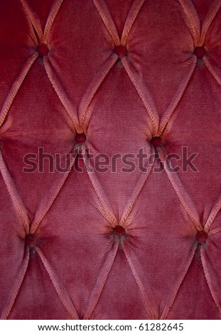 Luxury red fabric texture on an old sofa - stock photo