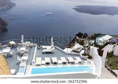 Luxury resort swimming pool in Santorini, Greece - stock photo