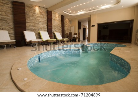 Luxury resort swimming pool with beautiful clean blue water and nice light effects around it. - stock photo