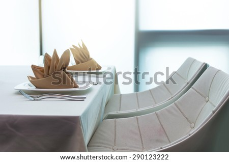 Luxury restaurant set with white chair - stock photo