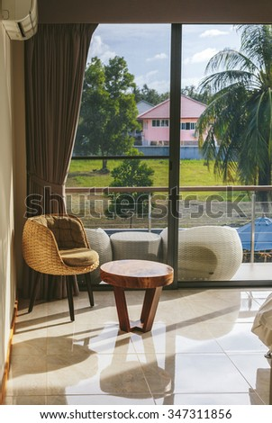 Luxury Room Interior with Big Window and tropical view  - stock photo