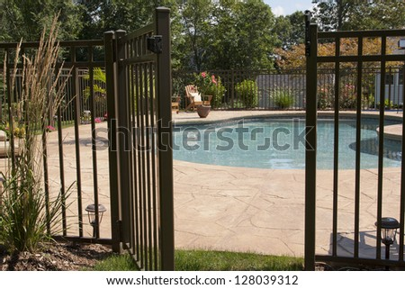 Luxury salt water pool and patio in a residential backyard. - stock photo