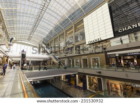 Luxury shopping center and Modern building in Singapore Singapore - October 23, 2014: Outlet in Marina Bay Sands shopping center and Modern building around Marina Bay - stock photo