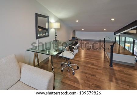 Luxury spacious modern nicely decorated den, home office in an  attic. Interior design. Vertical. - stock photo