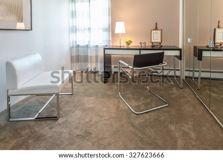 Luxury spacious modern nicely decorated den, home office with the table and the office chair. Interior design.