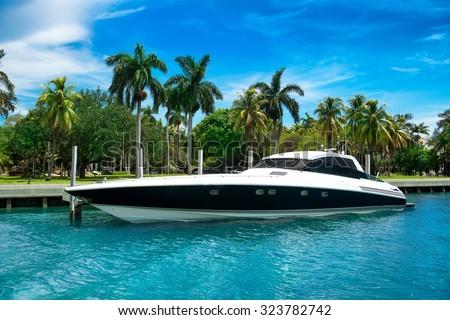 Luxury speed yacht near tropical island in Miami, Florida - stock photo