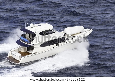 Luxury speedboat crashing through waves - stock photo