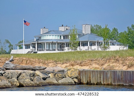 luxury summer cottage on the beach with driftwood log