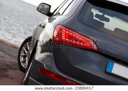 Luxury SUV rear light closeup - stock photo