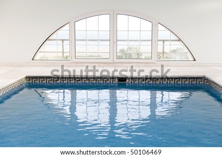 Luxury swimming pool with lot of windows. - stock photo