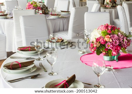 luxury table set for wedding or another catered event dinner - stock photo