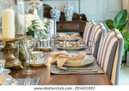 luxury table set in classic style dining room interior - stock photo