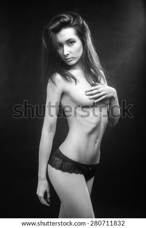 luxury topless woman in panties on black background monochrome - stock photo