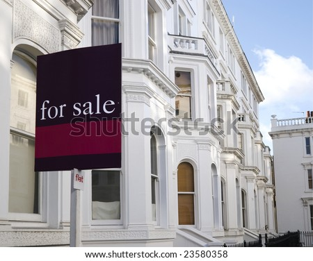 "Luxury townhouses with ""for sale"" sign and copy space.  at Kensington area(London). - stock photo"