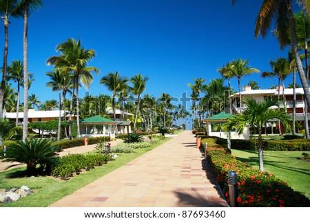 Luxury tropical hotel resort, road to ocean - stock photo