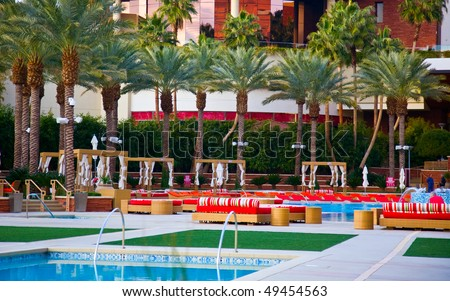 Luxury tropical resort with an inviting swimming pool - stock photo