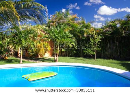 Luxury turquoise swim pool - stock photo