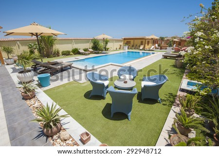 Luxury villa show home swimming pool in a tropical resort - stock photo