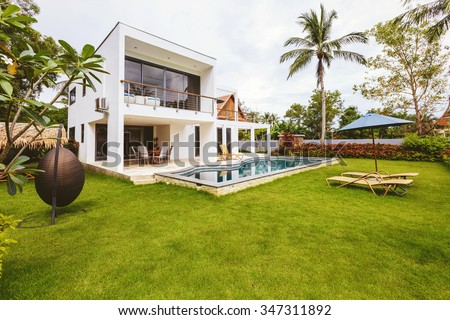 Luxury villa with swimming pool outside exterior view - stock photo