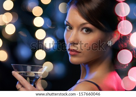 luxury, vip, nightlife, party concept - beautiful woman in evening dress with cocktail - stock photo