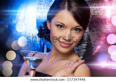 luxury, vip, nightlife, party concept - beautiful woman in evening dress with cocktail and disco ball - stock photo
