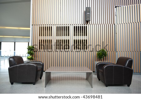 Luxury waiting room with plant against wooden wall - stock photo