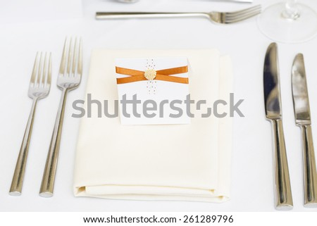 Luxury wedding gala table setting with blank personal greeting card - stock photo