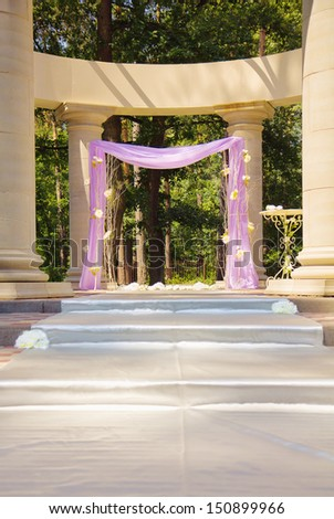 Luxury wedding gazebo with flowers in columns - stock photo