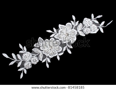 luxury wedding lace with pearls isolated on black background - stock photo