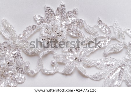 Luxury wedding lace with pearls on white background