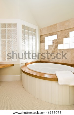 luxury white and wood bathroom with whirlpool tub