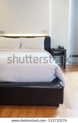 luxury white bedroom in apartment. - stock photo
