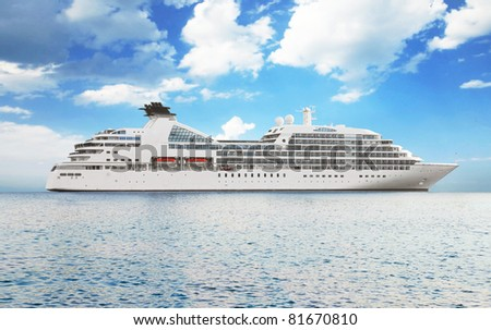 Luxury white cruise ship on a clear day with calm seas - stock photo