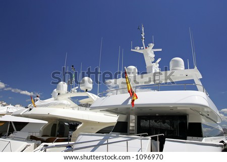 Luxury white yachts moored close to each other in Spain on a bright sunny day