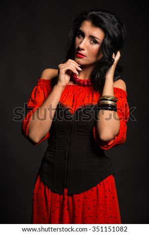 Luxury woman in a red dress