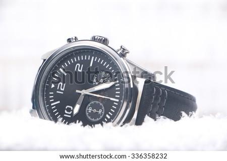 Luxury Wristwatch in Snow - stock photo