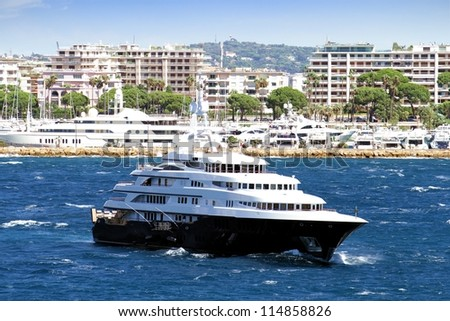 Luxury yacht anchored close to Cannes port, France. - stock photo