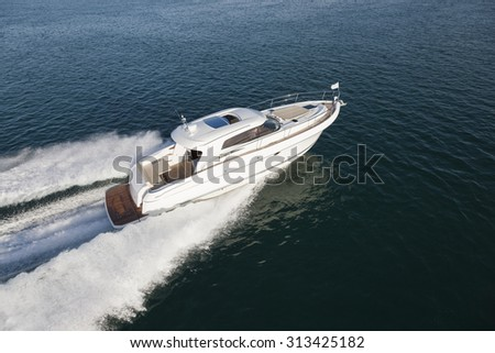 Luxury yacht cruising on the ocean on a sunny day