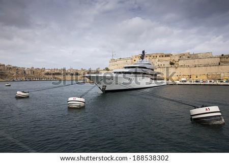 Luxury yacht in Grand Harbour of Valletta, Malta. - stock photo