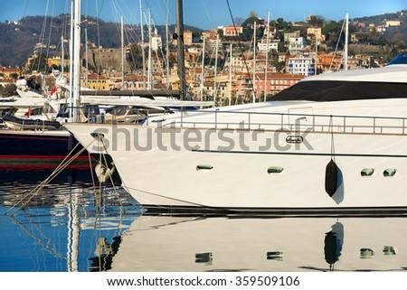 Luxury Yacht in the Harbor - La Spezia / Detail of a luxury yacht and sailboats in the harbor of La Spezia, Liguria, Italy - stock photo