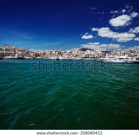 Luxury yachts and motor boats moored in Puerto Banus marina in Marbella, Spain. Marbella is a popular holiday destination located on the Costa del Sol in the southern Andalusia - stock photo