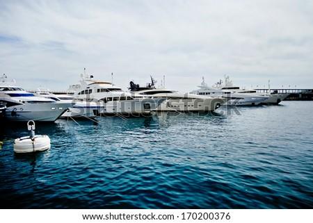 Luxury yachts in the Monte Carlo harbour, Monaco, Cote d'Azur - stock photo