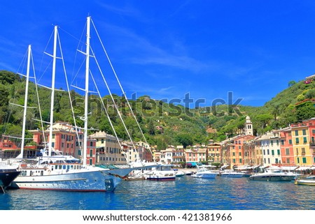 Luxury yachts inside the harbor of Portofino, Italy - stock photo