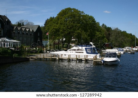 luxury yachts moored along the edge of lake windermere