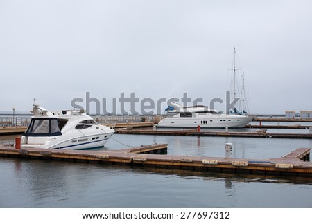 luxury yachts parked in a bay on the sea - stock photo