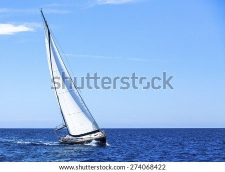 Luxury yachts. Sailing in the wind through the waves at the Aegean Sea.  - stock photo