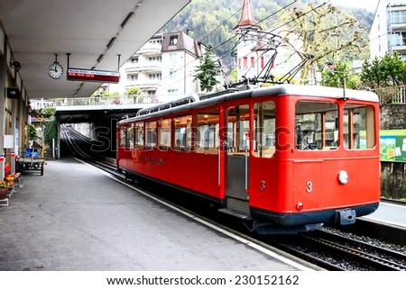 LUZERN APR 12: Tram to Mount Rigi in Luzern, Switzerland on April 12, 2012. Rigi railway is the Europe's oldest mountain railways. - stock photo