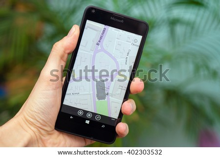 LVIV, UKRAINE - apr 06, 2016:  Microsoft Lumia 640 Windows Phone with Here Drive+ map on screen, navigation app in hand