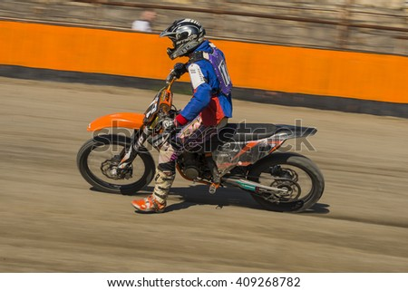 Lviv, Ukraine - 17 April 2016: Unknown rider overcomes the track at the  Flat Track  National Championship  to the Lviv city - stock photo